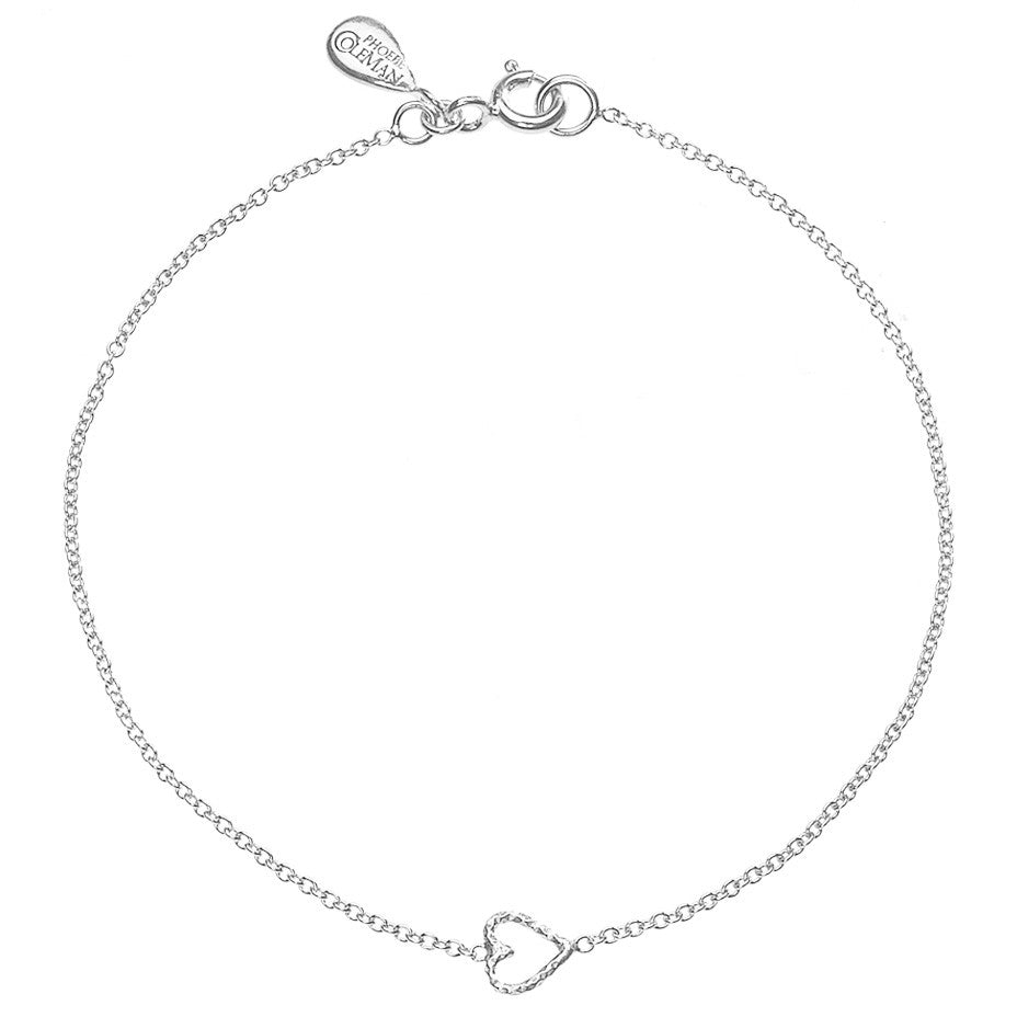 Love Me Tender Heart bracelet in silver, featuring an adorable tiny open heart.