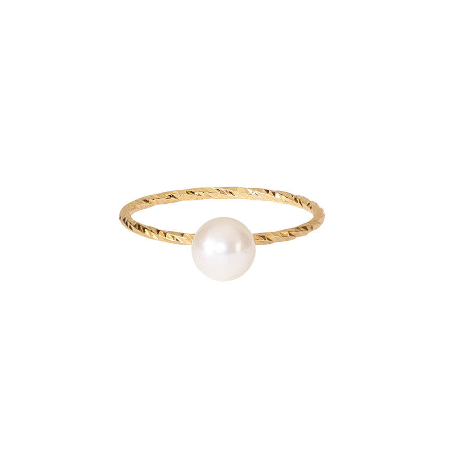 The Large Lunar White Pearl ring in gold, featuring a large Akoya pearl and sparkling band.