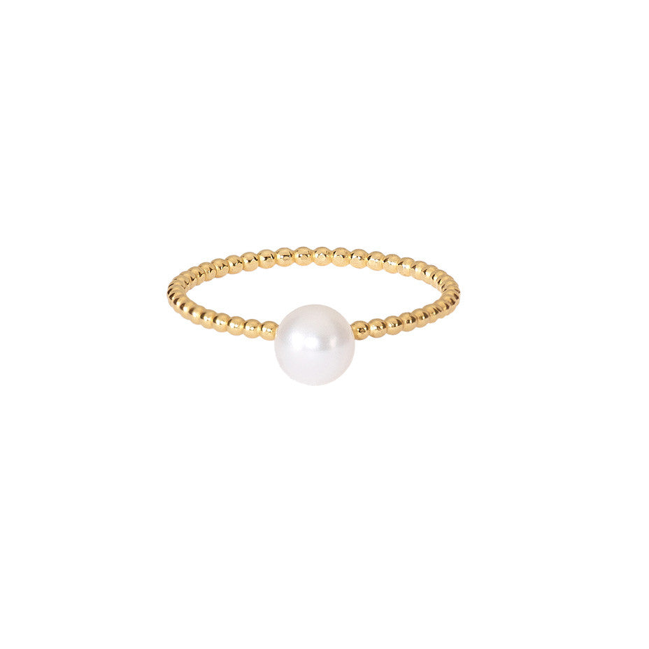 Lunar White Medium Pearl ring in gold, featuring a medium Akoya pearl set onto our beaded band.