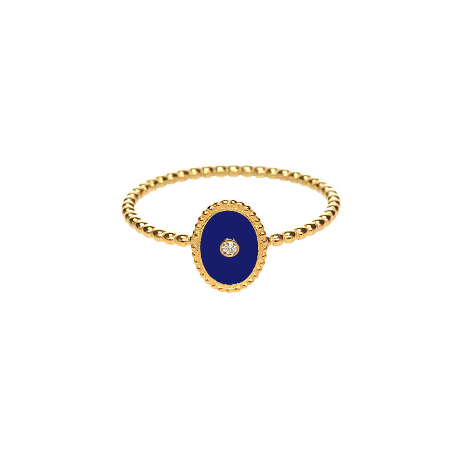 Midnight Love ring in gold, made from navy enamel and a white diamond.