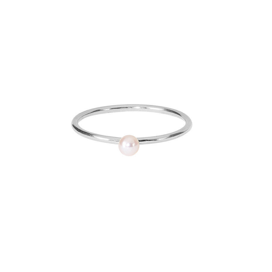 Lunar White Mini Pearl ring in silver, featuring a mini freshwater pearl on a simple silver band.