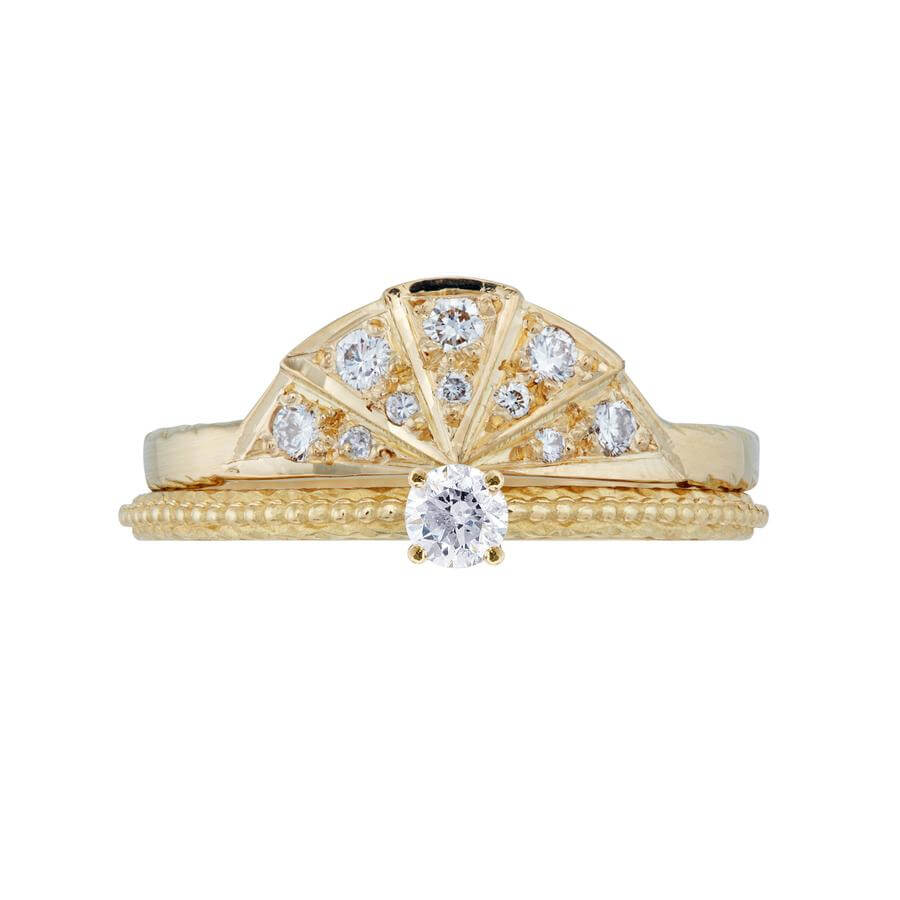 The white diamond solitaire Tender Love engagement ring in 18 carat yellow gold, combined with the white diamond Sunbeam wedding band.