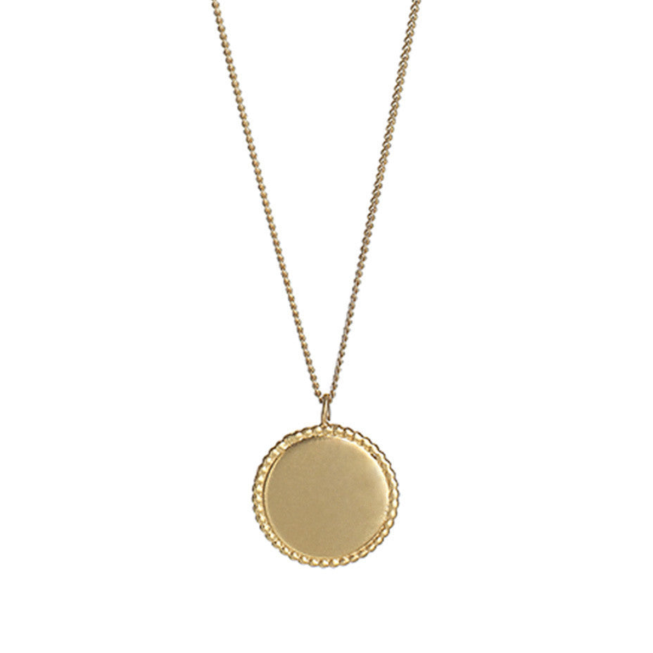 The Roman Disc necklace in gold, finished with a brushed satin.