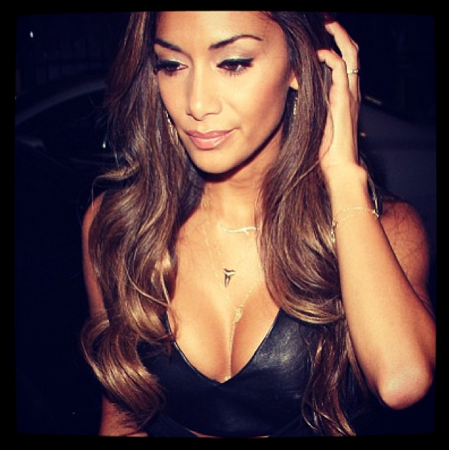Nicole Scherzinger wearing the Angel Wing and Lace Cross necklace in gold.