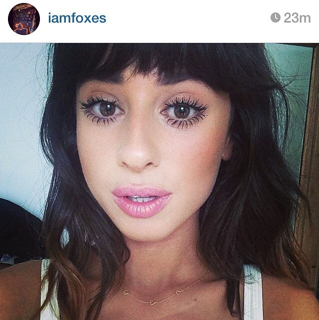Singer Foxes wears the Loop of Love necklace in gold.