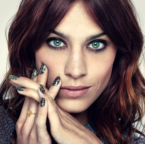 Alexa Chung wearing the Pure Heart ring in gold.