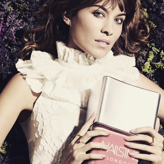 Alexa Chung wearing the Lunar White Large Pearl ring in gold.