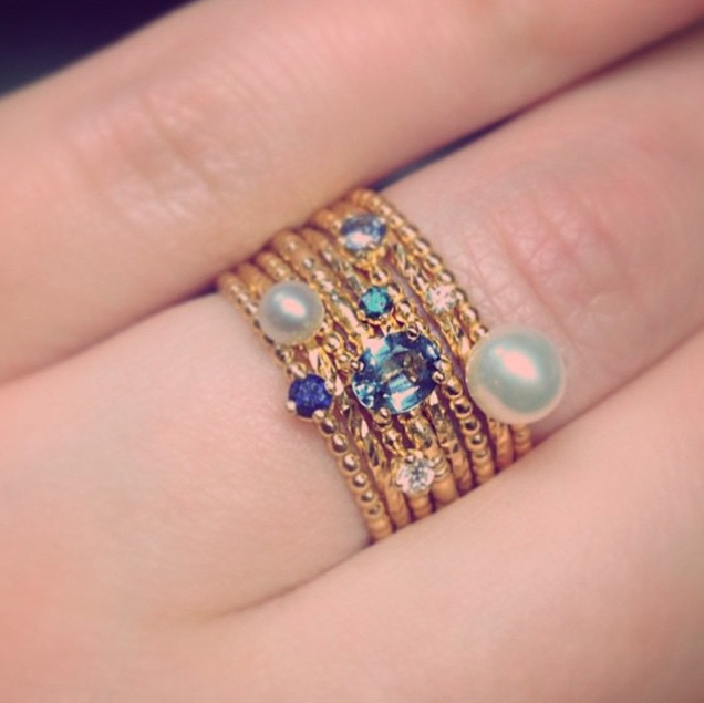 Combination of pearls, sapphires and diamond stacking rings in gold.