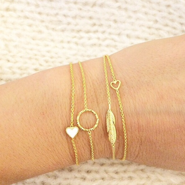 Selection of golden bracelets worn by customer.