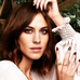 Alexa Chung wearing the Mini and Large Lunar Pearl Stacking rings in gold.