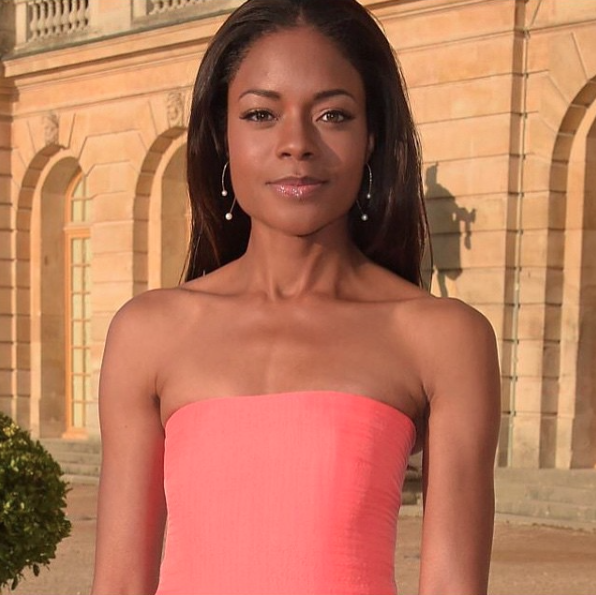 Naomi Harris wearing the I'm In Your Orbit Split Hoop White Pearl earrings in gold.