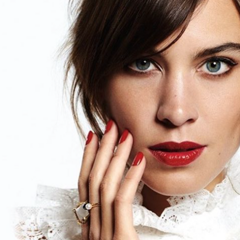 Alexa Chung wearing the Large Lunar Pearl and Sparkling Band ring in gold.