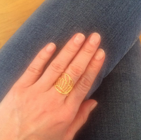 Angel Wing Wrap Around ring in gold worn by customer.