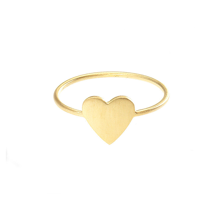 The Pure Heart ring in gold. A wafer thin heart sitting close to your finger finished with a beautiful satin sheen.