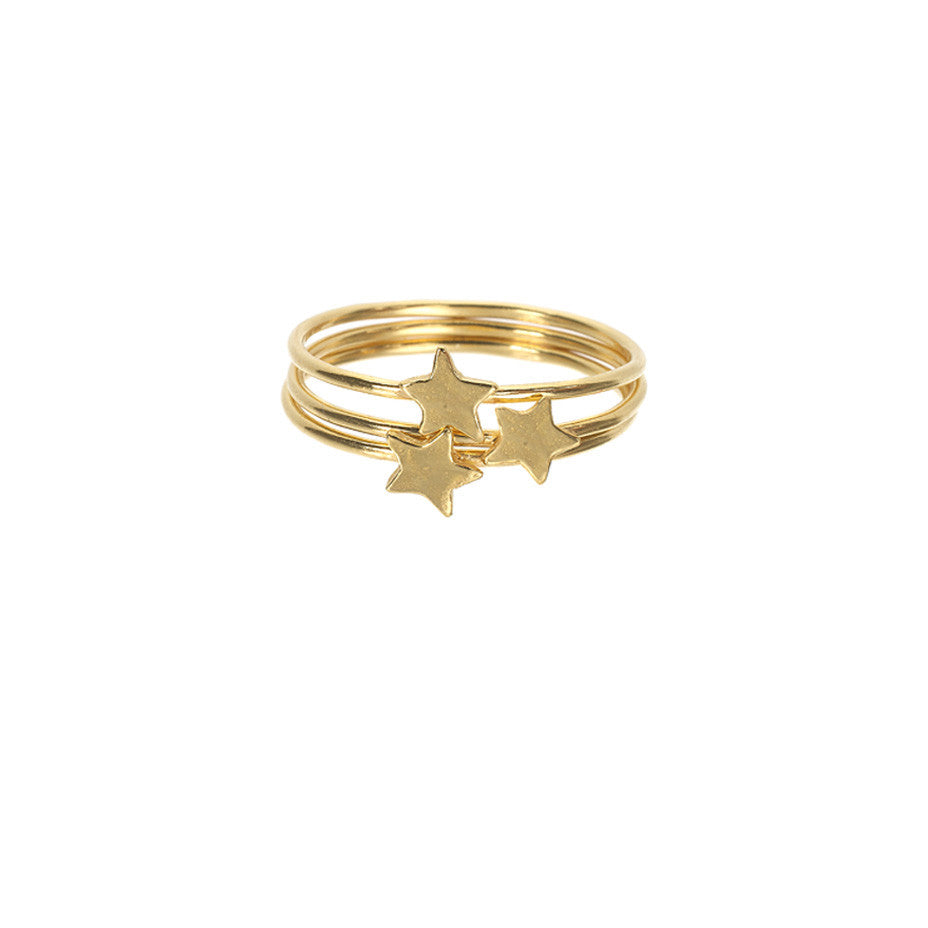 Star Stacking rings in gold, featuring three band rings with shiny stars sitting on top.