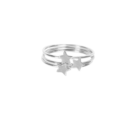 Star Stacking rings in silver, featuring three band rings with shiny stars sitting on top.