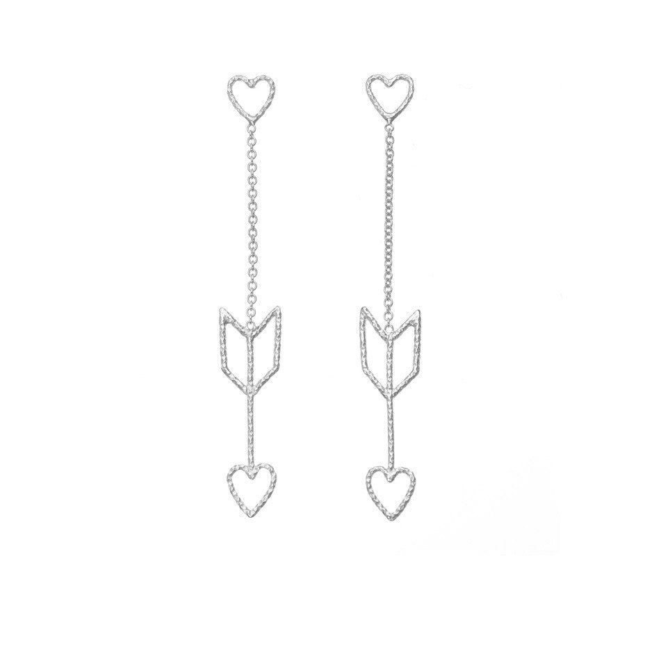 Arrow Of Love earrings in silver. The heart and arrow are attached to each other by delicate silver chain.