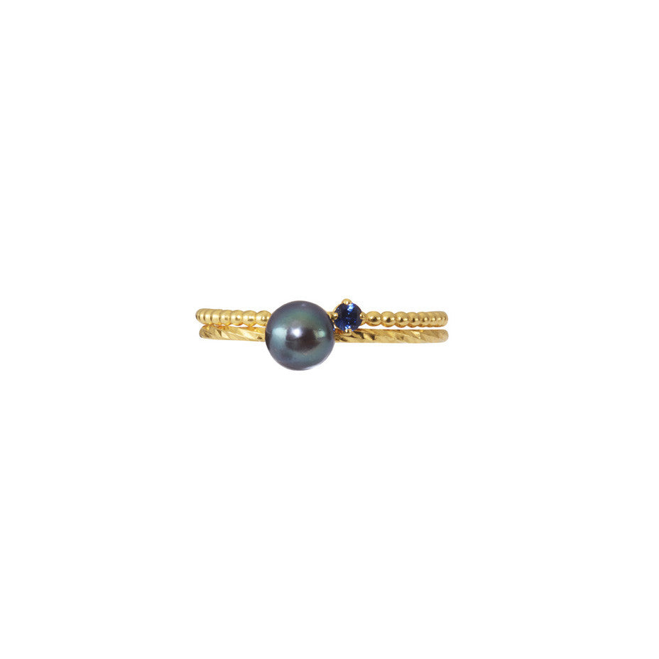 A combination of our signature multi faceted and beaded stacking rings adorned with Pirate's Black Pearl and Royal Blue sapphire.