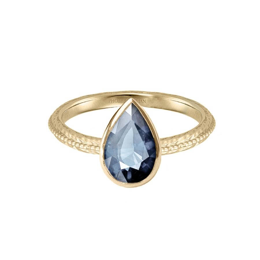 Pear shaped Harmony engagement ring in 18 carat yellow gold, with a blue grey sapphire.