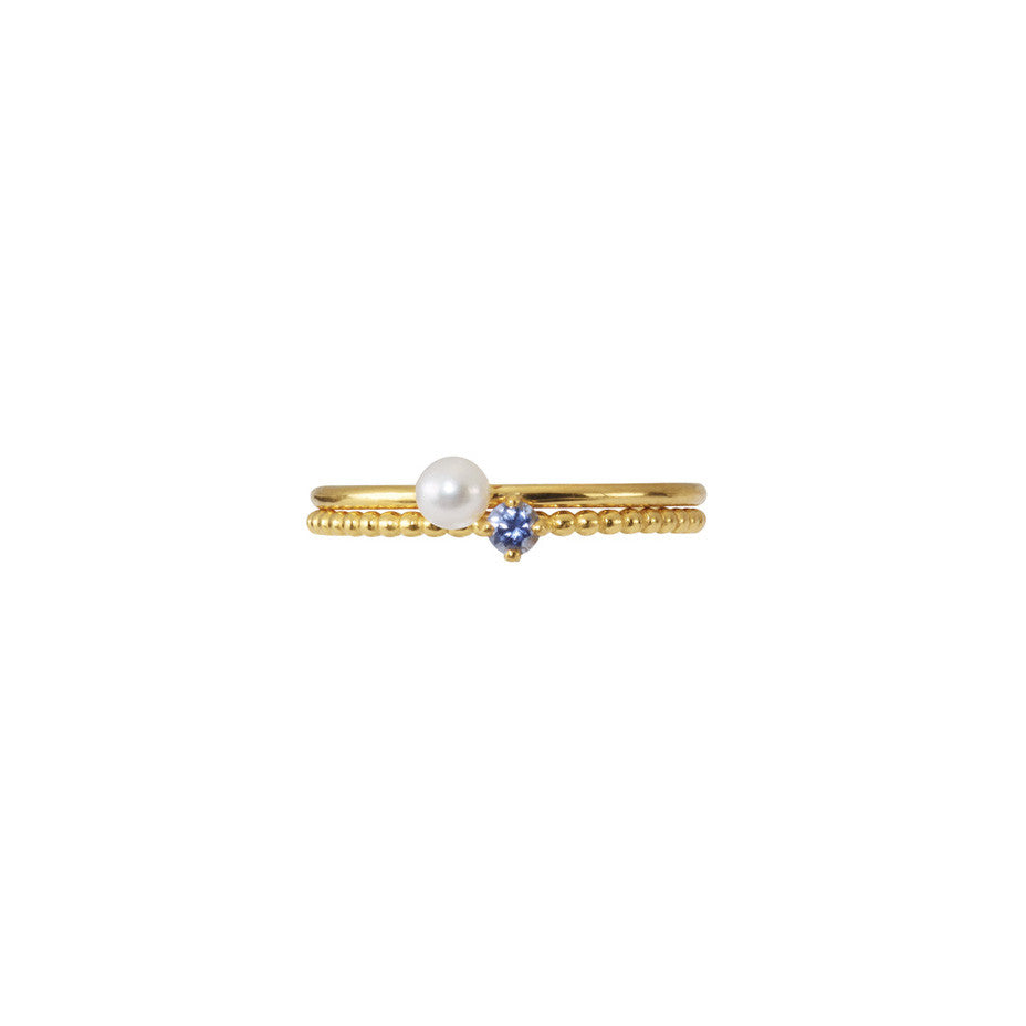 Mini White Pearl and Light Blue Sapphire Stacking duo in gold.