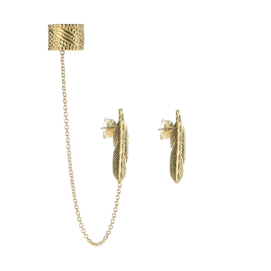 Warrior Ear Cuff and Feather Stud earrings in gold, featuring little feather studs and an ear cuff connect by a delicate chain.