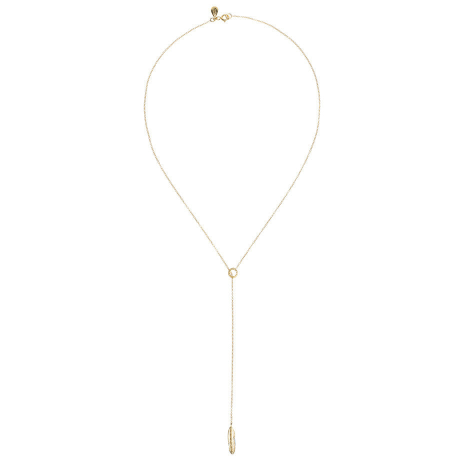 Take Flight Feather Lariat necklace in gold, featuring a small circle and feather. Full view.