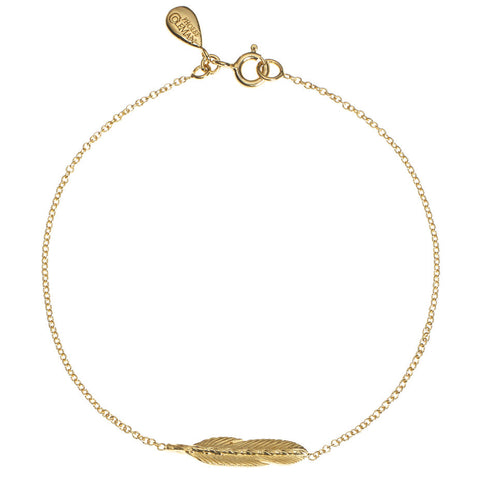 Take Flight Feather bracelet in gold.