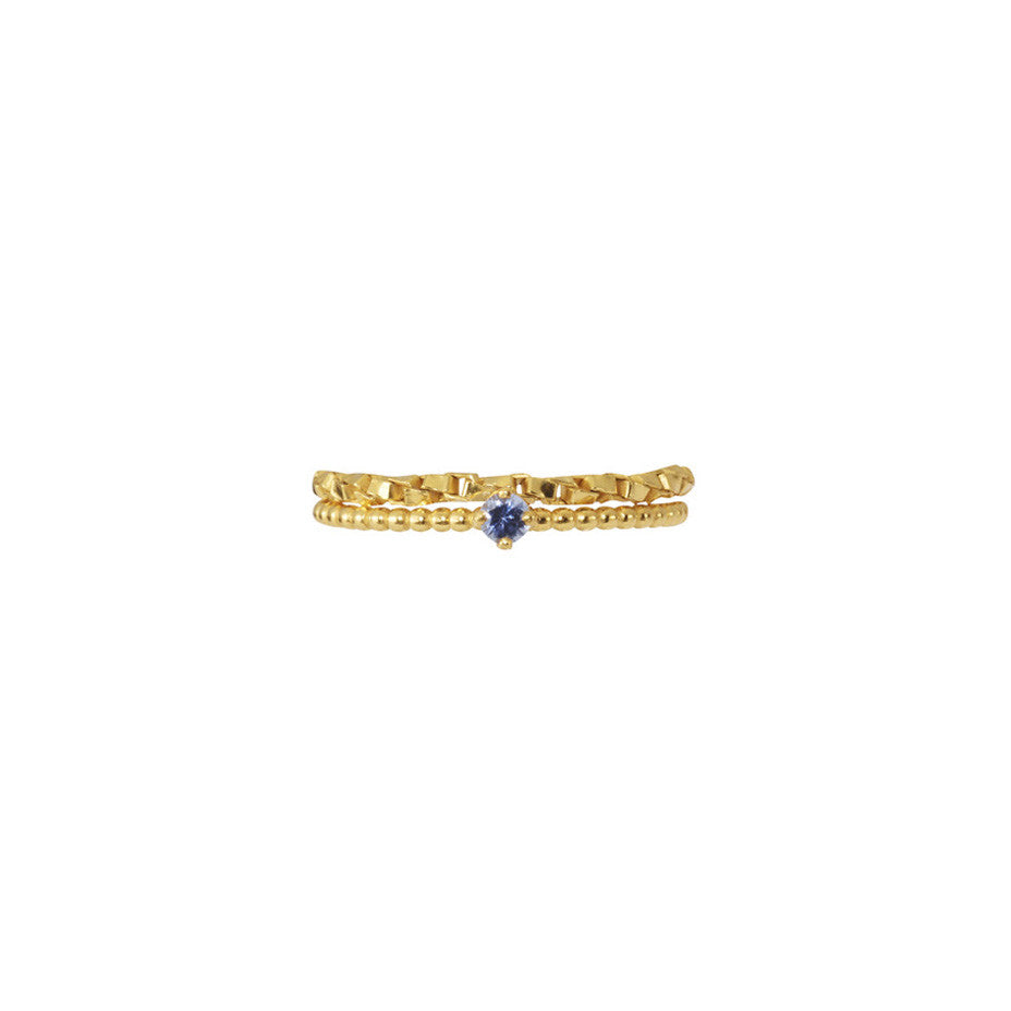 We've paired our dainty beaded Forget-Me-Not Blue Sapphire gold ring with our Chain Reaction Ring for a modern take on a a timeless classic.