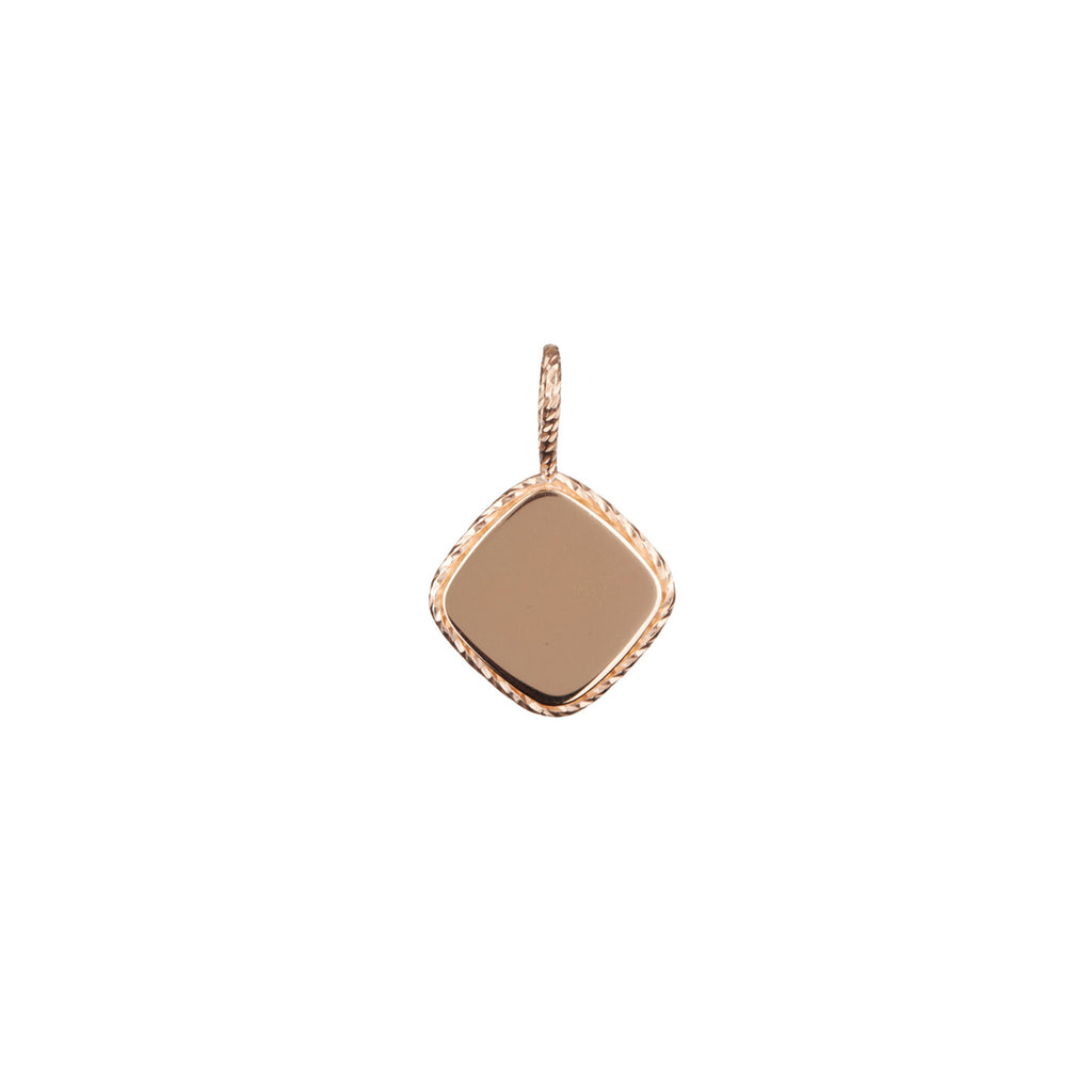 The Elements charm in rose gold, fashioned from a gleaming, weighty charm, with four rounded corners.