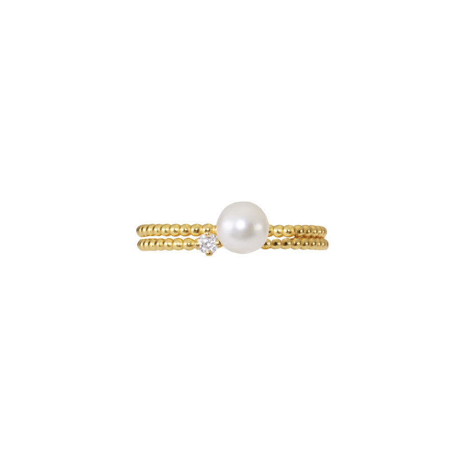Lily White Diamond and Lunar White Medium Pearl Stacking duo in gold.