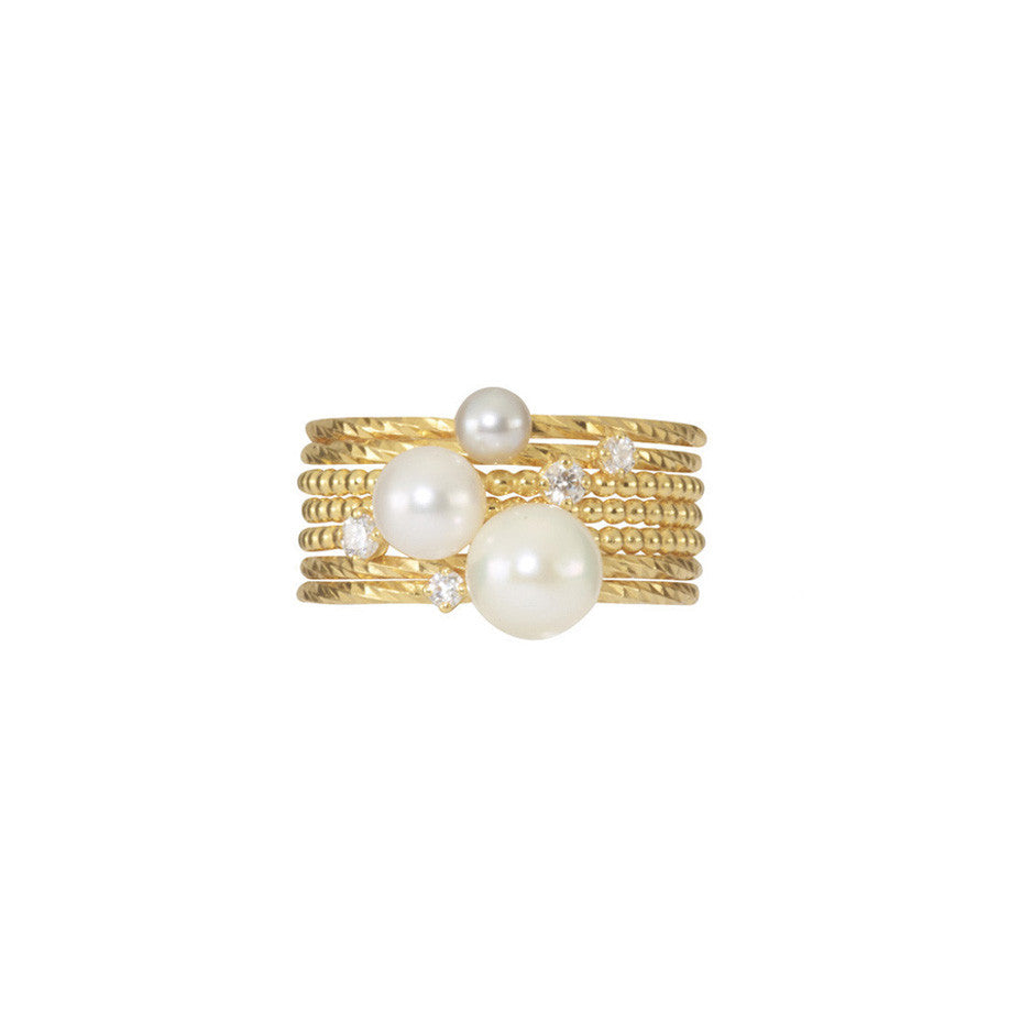 The Dreamer Stacking set in gold, featuring a combination of Lunar White, Lily White and London Mist pearls together with a scattering of diamonds.