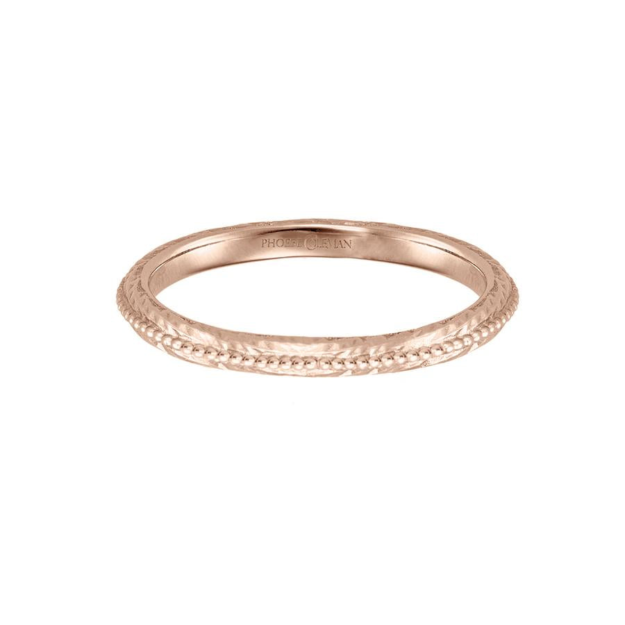 Eternal wedding band in 18 carat rose gold, featuring a textured band with a beaded line across the centre.