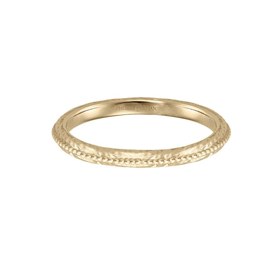 Eternal wedding band in 18 carat yellow gold, featuring a textured band with a beaded line across the centre.