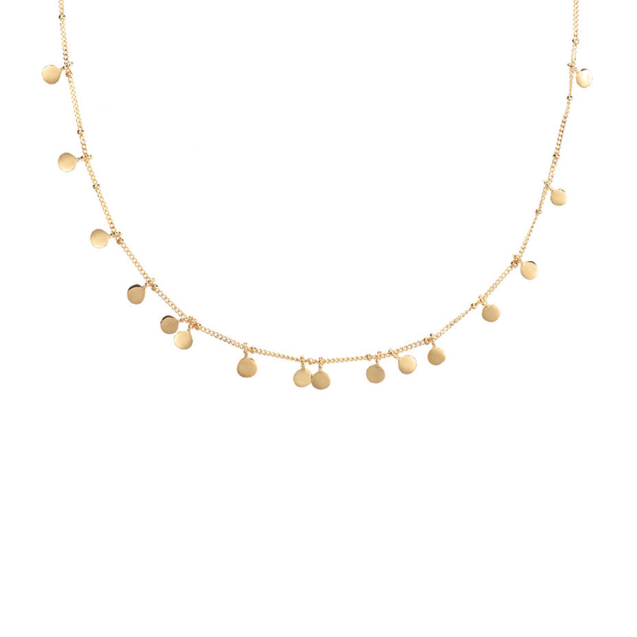 The gold Fortune Teller Coin necklace has 16 smooth and sparkling tiny coins that glide between the baubles on our shiny ball and curb chain.