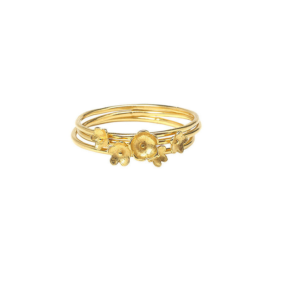 Summer Breeze Flower Stacking rings in gold, made from three rings each decorated with tiny flowers.