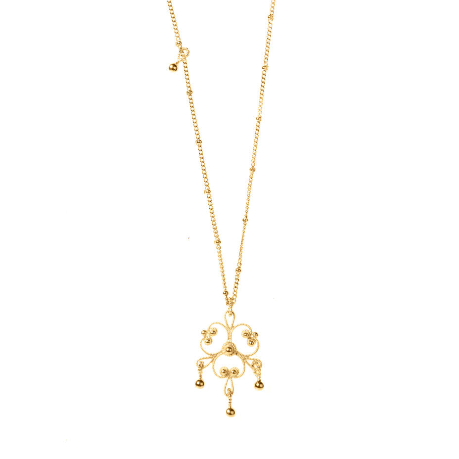 Gypsy Chandelier Long necklace in gold, featuring intricate lace-like designs inspired by traditional gypsy dresses.