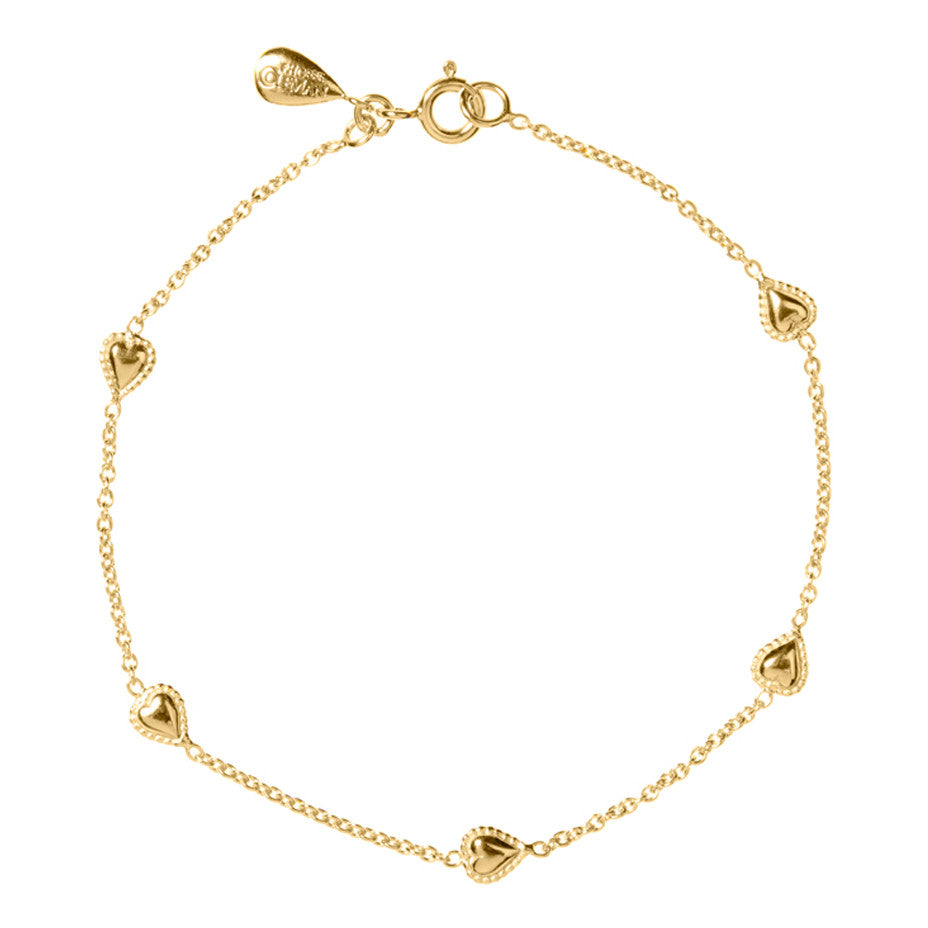 Gypsy Heart Bracelet in gold, featuring five tiny hearts, encapsulated by our signature beaded wire, interspersed on a fine gold chain.