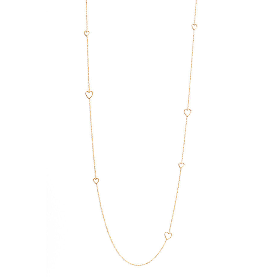 Follow Your Heart Long necklace in gold, featuring textured cut out hearts inserted into a delicate chain.