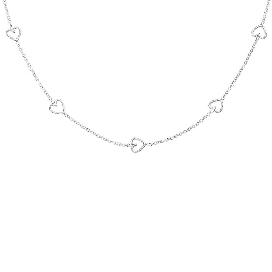 The Loop Of Love necklace in silver, featuring 5 tiny open hearts.