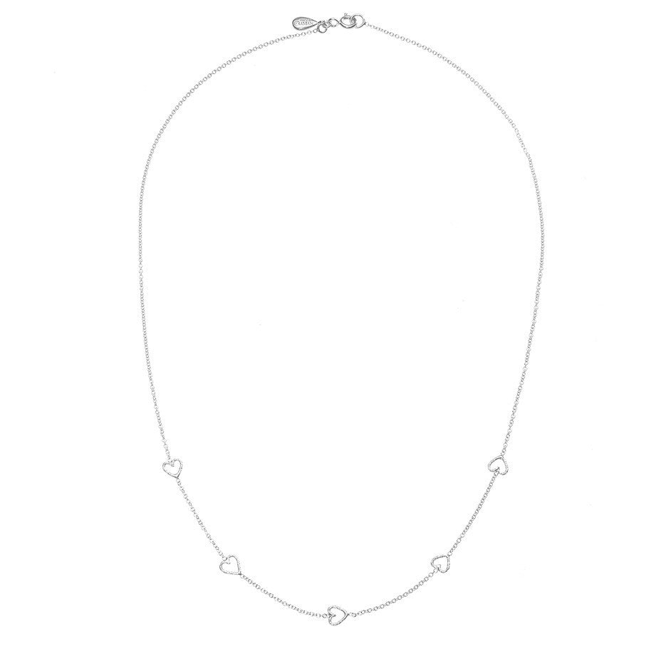 The Loop Of Love necklace in silver, featuring 5 tiny open hearts. Full view.