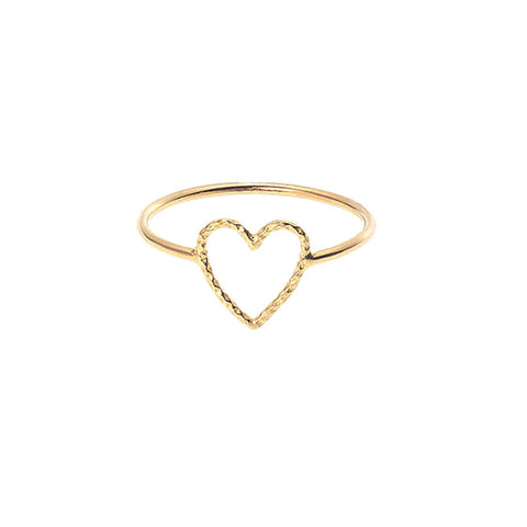 Love Me Tender ring in gold with textured cut out heart sits prettily on your finger.