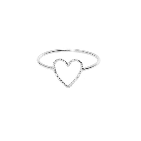 Love Me Tender ring in silver with textured cut out heart sits prettily on your finger.