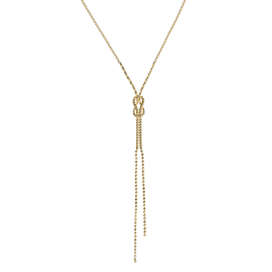 Lover's Sailor Knot necklace in gold, featuring a knotted design in both beaded an diamond cut wire.