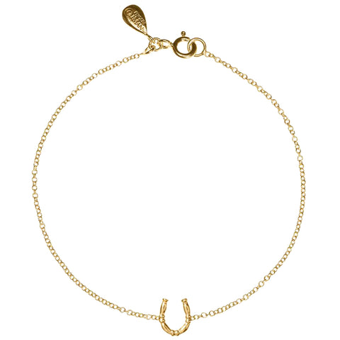 Lucky Horseshoe bracelet in gold, featuring a little horseshoe made from our equine bridle wire.