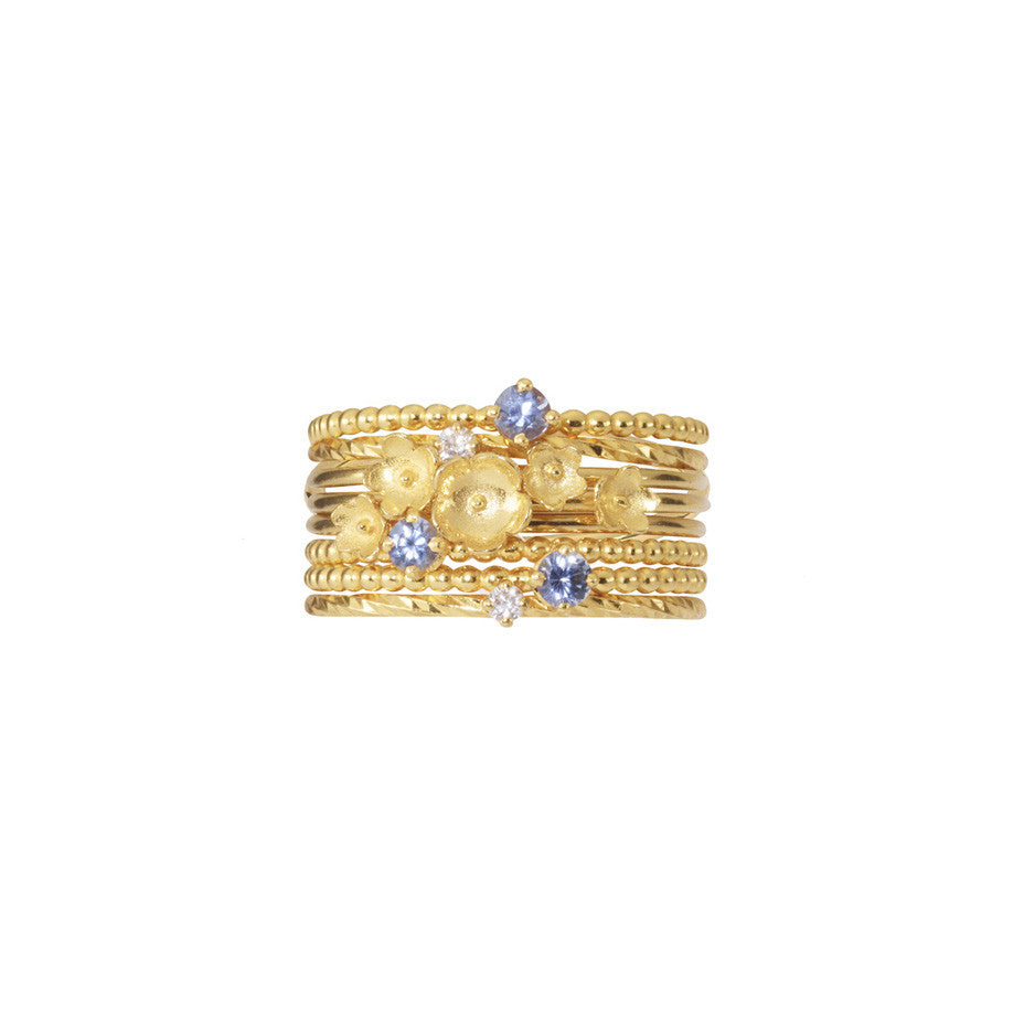 Nature Lover Stacking set in gold, featuring little flowers, white diamonds and blue sapphires.