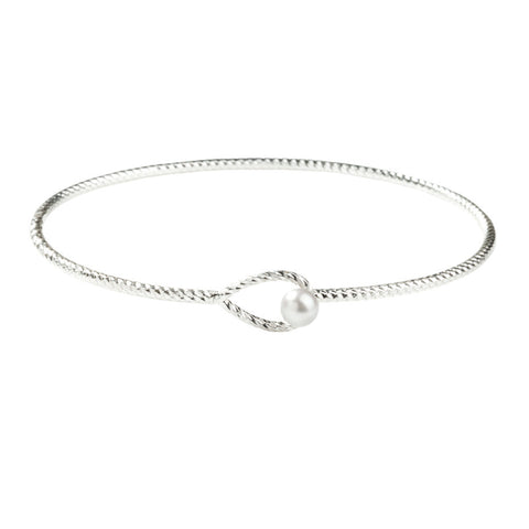 Orbital Loop Grey Pearl bangle in silver, featuring a wide multifaceted diamond cut wire bangle with a grey pearl and locking plume.