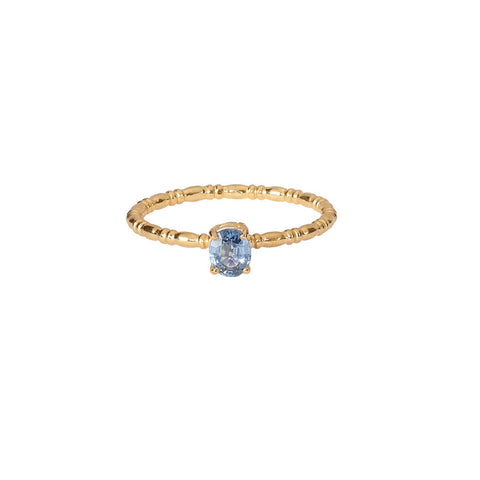Blue Sapphire Stacking ring in gold, featuring a claw set sapphire upon our gold Equine band.