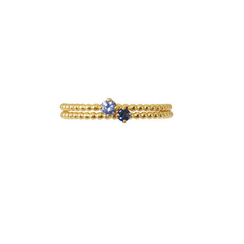 Our Forget-Me-Not blue and Royal Blue sapphires adorn our signature beaded bands in gold.