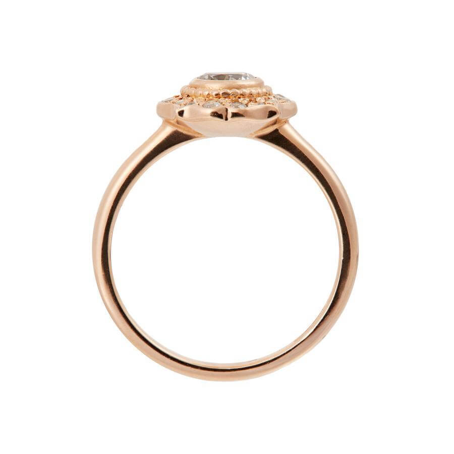 Side view of the Paradise white diamond halo engagement ring, which has a traditional vintage feel with a modern edge. Made from 18 carat rose gold.