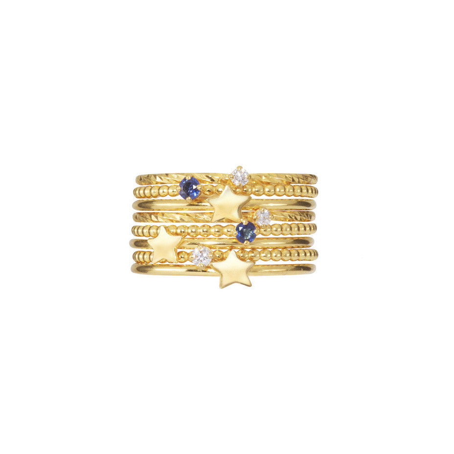 Party Girl Stacking set in gold, featuring royal blue sapphires, baby white diamonds and gold stars.
